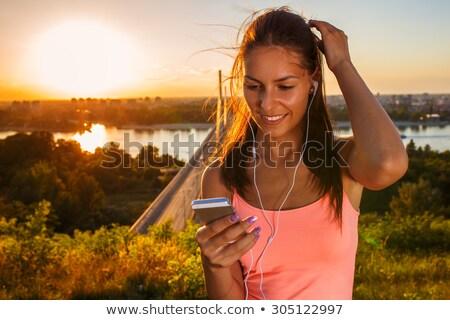 Woman runner listening to music on ipod Stock photo © IS2