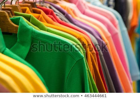 Colorful t-shirts arranged in a row on cloth rack Stock photo © wavebreak_media