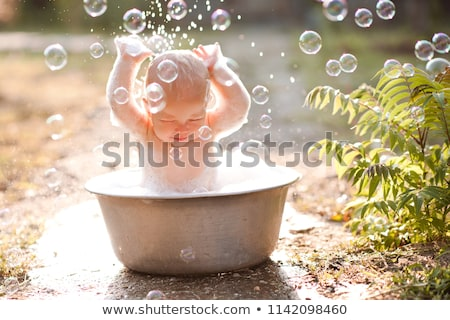 little pretty baby boy take bath in green tub Stock photo © Traimak