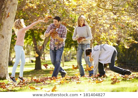family throwing autumn leaves into air Stock photo © IS2