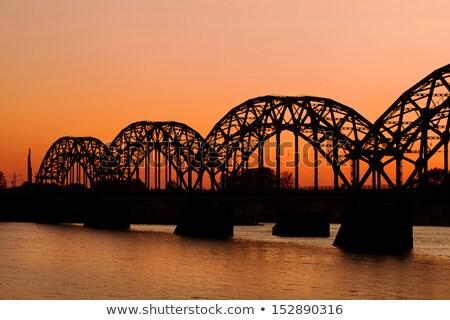 Ferrovia ponte Riga pôr do sol Látvia água Foto stock © benkrut