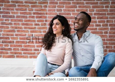 Stockfoto: Paar · vergadering · home · vrouw · gelukkig