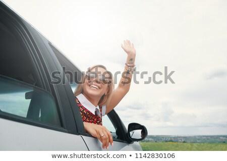 Fiatal nő integet autó ablak nyár utazás Stock fotó © IS2