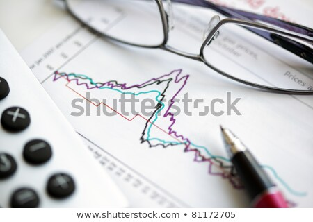Paper document with business graph, pen, calculator and spectacles Stock photo © wavebreak_media