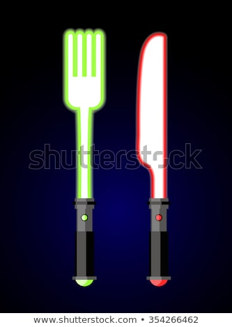 light cutlery knife and fork in style of future star war glow stock photo © popaukropa