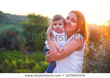 Young beatiful woman with baby outdoors Stock photo © dashapetrenko