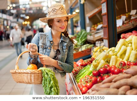 Woman in market looking at potatoes smiling Stock photo © monkey_business