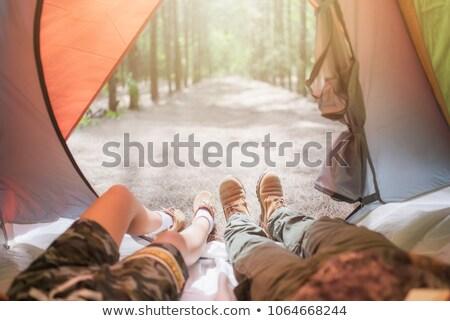 Nő nyújtás kívül sátor női vakáció Stock fotó © IS2