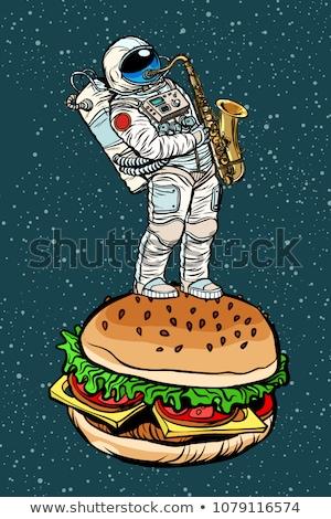 Astronaut plays saxophone on a Burger Stock photo © studiostoks