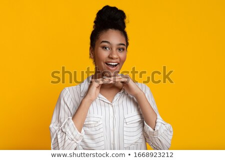 Girl leaning with hands on chin Stock photo © IS2