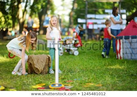 children playing ring toss scene Stock photo © bluering