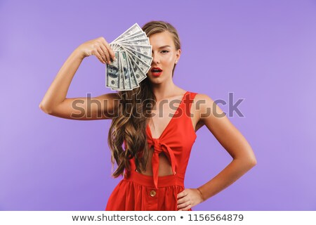 Photo closeup of rich european woman 20s wearing red dress holdi Stock photo © deandrobot