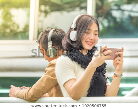 Image of excited asian teenage gamer boy playing video games on  Stock photo © deandrobot