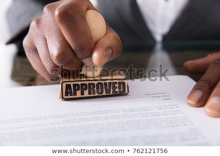 Businesswoman Stamping On Approved Contract Form Stock photo © AndreyPopov