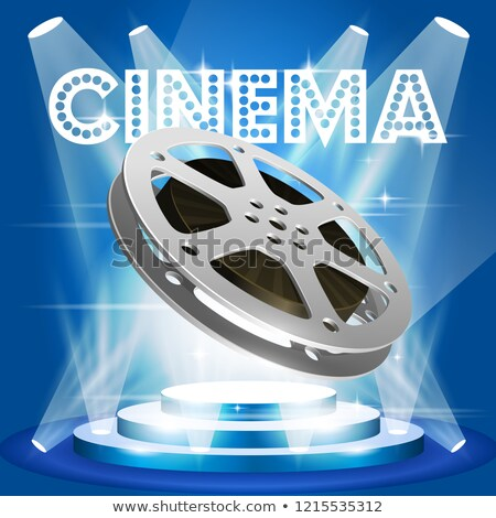 Old film reel on illuminated pedestal - movie premiere poster Stock photo © gomixer
