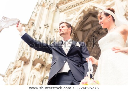 Bride looking at bridegroom flying napkin in air Stock photo © Kzenon