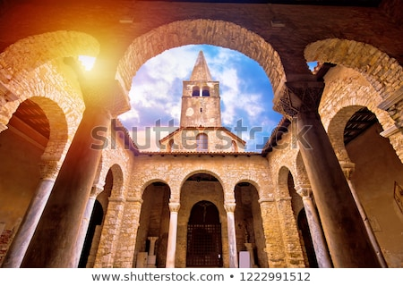 Stock photo: Euphrasian Basilica in Porec arcades and tower sun haze view