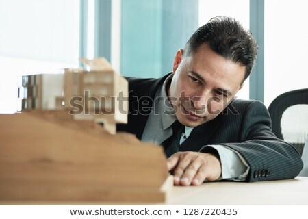 Confident Businessman Looking At Architecture Miniature House Project Stock photo © diego_cervo