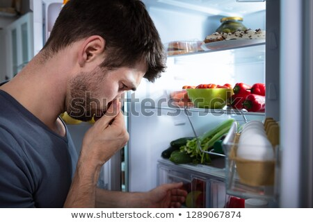 Man Recognizing Bad Smell From The Refrigerator Stock photo © AndreyPopov