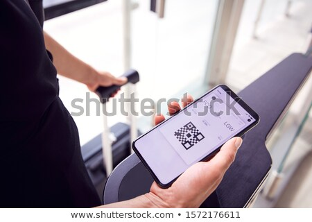 Person Looking At Boarding Pass On Mobilephone Stock photo © AndreyPopov