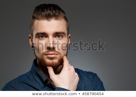 Portrait of a calm young bearded man Stock photo © deandrobot