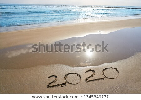 year 2020 numbers spell written on beach Stock photo © lunamarina