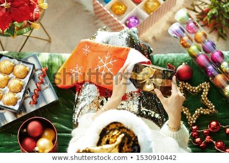 Kadın Noel hediye kutusu stoklama tatil insanlar Stok fotoğraf © dolgachov