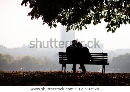 Personnes séance banc ville parc saison d'automne Photo stock © robuart