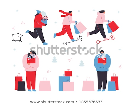 Happy girl walking after shopping with boxes and bags. stock photo © studiolucky