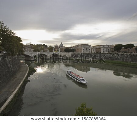 rome riverfront and tiber river bridges stock photo © xbrchx