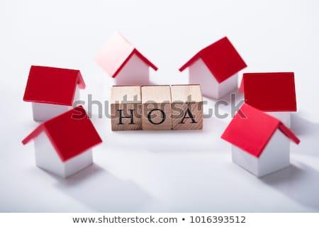 Háztulajdonos szöveg házak emberek tart ház Stock fotó © AndreyPopov