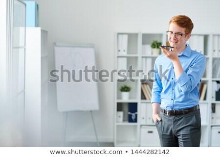 красивый молодые бизнесмен голосом смартфон Сток-фото © pressmaster