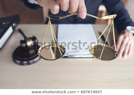 Male lawyer working with gavel and note paper report the case on Stock photo © Freedomz
