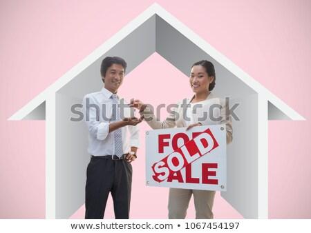 два человека продажи знак ключами дома Сток-фото © wavebreak_media