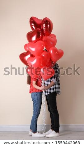 Casal ocultação atrás vermelho coração Foto stock © dolgachov