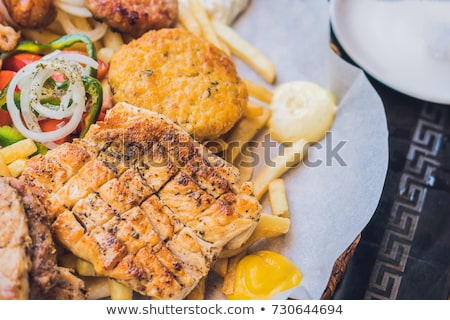Big set Greek food Meat plate with potatoes and sauce Stock photo © galitskaya