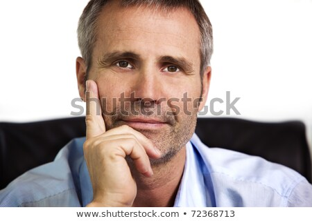 Close-up of confident businessman resting chin on hand. Stock photo © lichtmeister