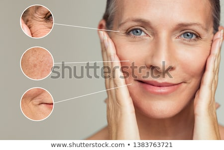 portrait of smiling senior woman touching her face Stock photo © dolgachov