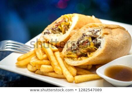 Greek food concept. Bun with chicken salad, french fries Stock photo © galitskaya