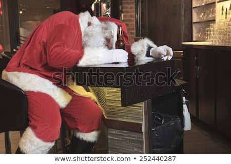 Santa claus sleep at the bar. Too drunk. Stock photo © Lopolo