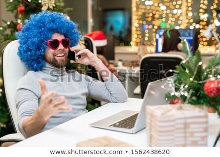 Boldog irodai dolgozó napszemüveg kék fürtös paróka Stock fotó © pressmaster