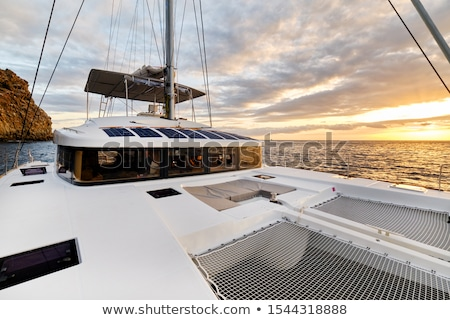 Solar powered catamaran at sunset, fully sustainable and powered Stock photo © amok
