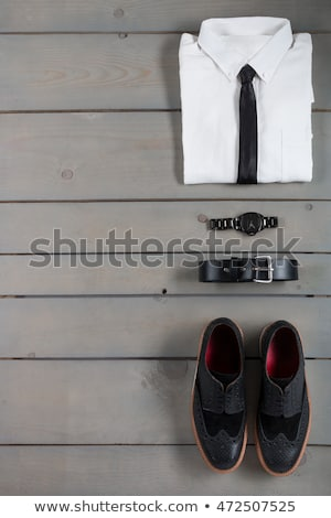 Businessman, work outfit on grey wooden background. Stock photo © Illia