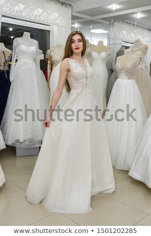 Woman as bride to be looking for bridal wear in a wedding shop Stock photo © Kzenon