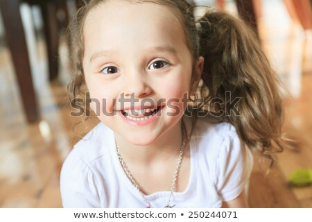 Three year old cute girl playing with connecting blocks Stock photo © Lopolo