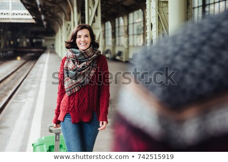 Happy woman with suitcase meets her husband, comes from abroad, has unforgettable meeting. Couple in Stock photo © vkstudio