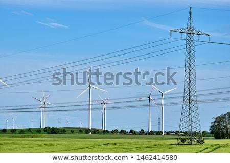 Távvezeték szél napos idő égbolt technológia ipari Stock fotó © elxeneize