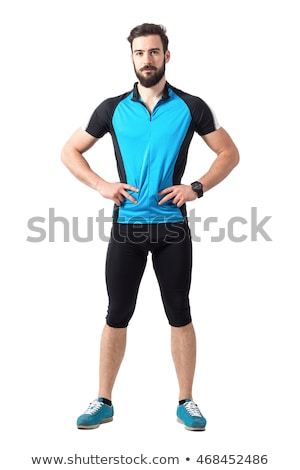 Image of young strong man in sportswear posing and looking at camera Stock photo © deandrobot