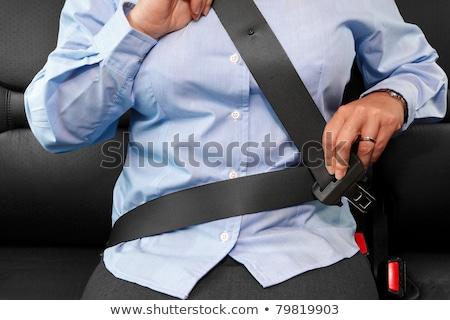 zakenvrouw · zitting · gordel · auto · vrouw · gelukkig - stockfoto © rtimages