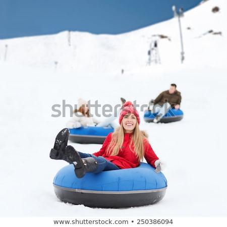 man snow tubing from hill. winter activity concept Stock photo © galitskaya